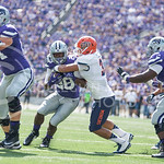 Sophomore running back Jarvis Leverett Jr. gets tackled by a UTEP player during the game vs. UTEP on Sept. 27, 2014 in Bill Snyder Family Stadium. (George Walker | The Collegian)