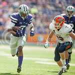 Junior double back Danzel McDaniel gets tackled by a UTEP player during the game vs. UTEP on Sept. 27, 2014 in Bill Snyder Family Stadium. (George Walker | The Collegian)