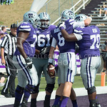 J. Hubener and W. Ash congratulate one another after a Wildcat Touchdown at the KSU vs. UTEP football game at Bill Synder Family Statium on September 27, 2014. (Cassandra Nguyen | The Collegian)