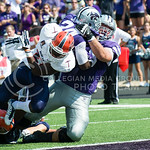 K-State running back Charles Jones is dragged across the goal line by Offensive lineman Cody Whitehair on Saturday, September 27, 2014 at Bill Snyder Family Stadium.