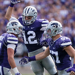 K-State defensive end Weston Hiebert celebrates a tackle with his teammates Kendall Adams and Colborn Couchman on Saturday, September 27, 2014 at Bill Snyder Family Stadium.