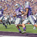 Freshman doubleback Kaleb Prewett celebrates after Senior wide receiver Tyler Lockett scores a touchdown during the game vs. UTEP on Sept. 27, 2014 in Bill Snyder Family Stadium. (George Walker | The Collegian)