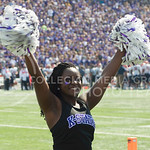 A Kansas State Cheerleader cheering on the field at the KSU vs. UTEP football game at Bill Synder Family Statium on September 27, 2014. (Cassandra Nguyen | The Collegian)