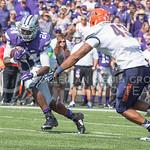 Sophomore running back Charles Jones avoids UTEP defensive line Roy Robertson-Harris during the game vs. UTEP on Sept. 27, 2014 in Bill Snyder Family Stadium. (George Walker | The Collegian)