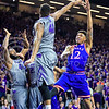 Kansas guard Kelly Oubre, Jr. attempts to put in a floater over junior forward Stephen Hurt (41) in the first half of the Wildcats' 70-63 victory over the #8-ranked Jayhawks in the 281st Sunflower Showdown February 23, 2015, in Bramlage Coliseum. (Parker Robb | The Collegian)