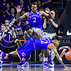 Kansas guard Kelly Oubre, Jr., (12) dives for a loose ball fumbled by Kansas forward Cliff Alexander (2) and K-State senior forward Thomas Gipson in the first half of the Wildcats' 70-63 victory over the #8-ranked Jayhawks in the 281st Sunflower Showdown February 23, 2015, in Bramlage Coliseum. (Parker Robb | The Collegian)