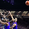 Senior forward Thomas Gipson passed the ball over Kansas forward Perry Ellis (right) and forward Cliff Alexander (middle) to senior forward Nino Williams (not pictured) in the second half of the Wildcats' 70-63 victory over the #8-ranked Jayhawks in the 281st Sunflower Showdown February 23, 2015, in Bramlage Coliseum. (Parker Robb | The Collegian)