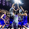K-State and Kansas players battle for a rebound in the second half of the Wildcats' 70-63 victory over the #8-ranked Jayhawks in the 281st Sunflower Showdown February 23, 2015, in Bramlage Coliseum. (Parker Robb | The Collegian)