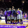 The 'Cats huddle at midcourt as they trail the Jayhawks by one point with 40 seconds left in the first half of the Wildcats' 70-63 victory over the #8-ranked Jayhawks in the 281st Sunflower Showdown February 23, 2015, in Bramlage Coliseum. (Parker Robb | The Collegian)