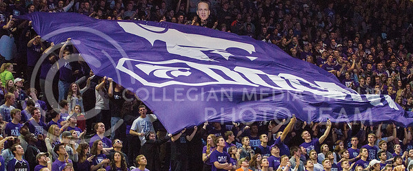The Kansas State University student section holds up the Octagon of Doom sign during the Sunflower Showdown. The K-State Wildcats defeated the Jayhawks 70-63 on February 24. (Mason Swenson | The Collegian)