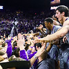 K-State players celebrate with fans on the court following their second home upset victory over #8-ranked archrival Kansas in as many years in the 281st Sunflower Showdown February 23, 2015, in Bramlage Coliseum. (Parker Robb | The Collegian)