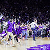 K-State students spill onto the court following the Wildcats' second victory in as many years over #8-ranked archrival Kansas in Bramlage Coliseum February 23, 2015. The court storming drew national media attention, as the Jayhawks were unable to get to their locker room, a K-State student intentionally plowed into Kansas forward Jamari Traylor, and Kansas head coach Bill Self was pinned against the scorers' table amidst the ensuing rush of fans. (Parker Robb | The Collegian)