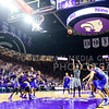Senior forward Nino Williams hits two free throws to put the 'Cats up 66-61, all but ensuring a victory, with a minute remaining in the second half of the Wildcats' 70-63 victory over the #8-ranked Jayhawks in the 281st Sunflower Showdown February 23, 2015, in Bramlage Coliseum. Williams was instrumental in securing the Wildcat victory, making three free throws, a bucket, and grabbing a defensive rebound in the final minute of the game. (Parker Robb | The Collegian)