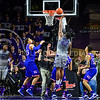 Senior forward Thomas Gipson taps in a rebound from senior guard Nino Williams' (11) missed layup in the first half of the Wildcats' 70-63 victory over the #8-ranked Jayhawks in the 281st Sunflower Showdown February 23, 2015, in Bramlage Coliseum. (Parker Robb | The Collegian)
