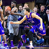 Senior forward Nino Williams grabs a defensive rebound to prevent Kansas from scoring in the final twenty seconds of the second half of the Wildcats' 70-63 victory over the #8-ranked Jayhawks in the 281st Sunflower Showdown February 23, 2015, in Bramlage Coliseum. (Parker Robb | The Collegian)