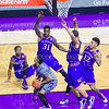 Junior guard Justin Edwards looks to make a bank shot over four Kansas defenders in the second half of the Wildcats' 70-63 victory over the #8-ranked Jayhawks in the 281st Sunflower Showdown February 23, 2015, in Bramlage Coliseum. (Parker Robb | The Collegian)