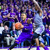 Kansas guard Frank Mason III drives around sophomore guard Nigel Johnson in the first half of the Wildcats' 70-63 victory over the #8-ranked Jayhawks in the 281st Sunflower Showdown February 23, 2015, in Bramlage Coliseum. (Parker Robb | The Collegian)
