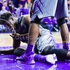 Senior forward Nino Williams examines his mouth after getting hit there by Kansas guard Kelly Oubre, Jr.'s elbow in the second half of the Wildcats' 70-63 victory over the #8-ranked Jayhawks in the 281st Sunflower Showdown February 23, 2015, in Bramlage Coliseum. Oubre was charged with a Flagrant I foul for the elbow swipe while trying to pass the ball away from Williams. (Parker Robb | The Collegian)