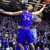 Kansas forward Perry Ellis and K-State senior forward Nino Williams juggle a rebound in the first half of the Wildcats' 70-63 victory over the #8-ranked Jayhawks in the 281st Sunflower Showdown February 23, 2015, in Bramlage Coliseum. (Parker Robb | The Collegian)