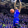 Kansas guard Devonte' Graham sinks a soaring dunk following a steal from junior guard Justin Edwards in the first half of the Wildcats' 70-63 victory over the #8-ranked Jayhawks in the 281st Sunflower Showdown February 23, 2015, in Bramlage Coliseum. (Parker Robb | The Collegian)