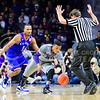 Sophomore guard Marcus Foster reaches for a misdribbled ball in the first half of the Wildcats' 70-63 victory over the #8-ranked Jayhawks in the 281st Sunflower Showdown February 23, 2015, in Bramlage Coliseum. (Parker Robb | The Collegian)
