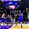 Senior foward Nino Williams drills a jumper off an assist from junior guard Justin Edwards to put the 'Cats up 60-54 with six minutes to play in the Wildcats' 70-63 victory over the #8-ranked Jayhawks in the 281st Sunflower Showdown February 23, 2015, in Bramlage Coliseum. Williams contributed 15 points to the victory. (Parker Robb | The Collegian)