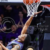 Sophomore forward Wesley Iwundu puts in a layup as he flies across the face of the backboard in the first half of the Wildcats' 70-63 victory over the #8-ranked Jayhawks in the 281st Sunflower Showdown February 23, 2015, in Bramlage Coliseum. (Parker Robb | The Collegian)