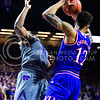 Kansas guard Kelly Oubre, Jr. knocks senior forward Nino Williams in the mouth with his elbow, for which he was charged with a Flagrant I personal foul, in the second half of the Wildcats' 70-63 victory over the #8-ranked Jayhawks in the 281st Sunflower Showdown February 23, 2015, in Bramlage Coliseum. (Parker Robb | The Collegian)