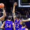 Sophomore guard Wesley Iwundu attempts a short shot over Kansas forward Perry Ellis and guard Kelly Oubre, Jr. in the first half of the Wildcats' 70-63 victory over the #8-ranked Jayhawks in the 281st Sunflower Showdown February 23, 2015, in Bramlage Coliseum. (Parker Robb | The Collegian)