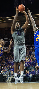 Senior forward Thomas Gipson pops up a shot on Nov. 17, 2014 at Bramlage Coliseum.  Gipson made 21 points in the game against UMKC.  (Rodney Dimick | The Collegian)