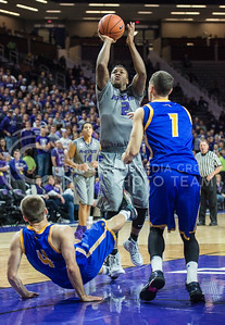 Sophomore guard Marcus Foster pops a shot on Nov. 17, 2014 at Bramlage Coliseum.  Foster has made a total of 29 points this semester.  (Rodney Dimick | The Collegian)