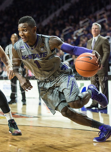 Sophomore guard Jevon Thomas dribbles around a player on Nov. 17, 2014 at Bramlage Coliseum.  Thomas has a total of 14 assists this season.  (Rodney Dimick | The Collegian)