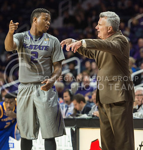 Sophomore guard Marcus Foster converses with head coach Bruce Weber on Nov. 17, 2014 at Bramlage Coliseum.  The Wildcats won against UMKC 83-73.  (Rodney Dimick | The Collegian)