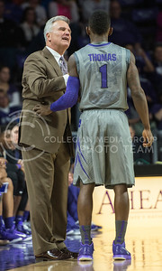Head coach Bruce Weber gives sophomore guard Jevon Thomas a few pointers on Nov. 17, 2014 at Bramlage Coliseum.  The Wilcats beat UMKC 83-73.  (Rodney Dimick | The Collegian)
