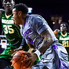 Sophomore guard Marcus Foster advances along the baseline past Baylor forward Johnathan Motley in the second half of the Wildcats' 63-61 come-from-behind victory over the #22 Bears Saturday, January 17, 2015, in Bramlage Coliseum. (Parker Robb | The Collegian)
