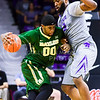 Senior forward Thomas Gipson blocks the advances of Baylor forward Royce O'Neale in the first half of the Wildcats' 63-61 come-from-behind victory over the #22 Bears Saturday, January 17, 2015, in Bramlage Coliseum. (Parker Robb | The Collegian)