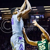 Junior forward Stephen Hurt attempts a jumper as Baylor guard Al Freeman rushes to defend him in the first half of the Wildcats' 63-61 come-from-behind victory over the #22 Bears Saturday, January 17, 2015, in Bramlage Coliseum. (Parker Robb | The Collegian)