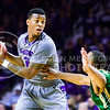 Sophomore guard Marcus Foster plays keep-away with Baylor guard Lester Medford as he looks to pass to a teammate in the first half of the Wildcats' 63-61 come-from-behind victory over the #22 Bears Saturday, January 17, 2015, in Bramlage Coliseum. (Parker Robb | The Collegian)