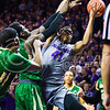 Junior forward Stephen Hurt attempts a layup as Baylor players knock the ball out of bounds in the first half of the Wildcats' 63-61 come-from-behind victory over the #22 Bears Saturday, January 17, 2015, in Bramlage Coliseum. (Parker Robb | The Collegian)