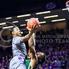Sophomore guard Marcus Foster attempts a layup over Baylor forward Rico Gathers in the first half of the Wildcats' 63-61 come-from-behind victory over the #22 Bears Saturday, January 17, 2015, in Bramlage Coliseum. (Parker Robb | The Collegian)