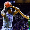 Junior forward Stephen Hurt looks to pass around Baylor guard Lester Medford in the first half of the Wildcats' 63-61 come-from-behind victory over the #22 Bears Saturday, January 17, 2015, in Bramlage Coliseum. (Parker Robb | The Collegian)