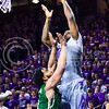 Senior forward Thomas Gipson puts in a layup over Baylor forward Rico Gathers in the first half of the Wildcats' 63-61 come-from-behind victory over the #22 Bears Saturday, January 17, 2015, in Bramlage Coliseum. (Parker Robb | The Collegian)