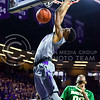Sophomore forward Wesley Iwundu nails a flying dunk off a lob from sophomore guard Marcus Foster in the second half of the Wildcats' 63-61 come-from-behind victory over the #22 Bears Saturday, January 17, 2015, in Bramlage Coliseum. (Parker Robb | The Collegian)