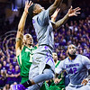 Sophomore guard Jevon Thomas lets the ball loose as he flies toward the rim in the first half of the Wildcats' 63-61 come-from-behind victory over the #22 Bears Saturday, January 17, 2015, in Bramlage Coliseum. (Parker Robb | The Collegian)