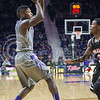 K-State guard Jevon Thomas passes the ball during the game against Nebraska-Omaha on Dec. 2, 2014 at Bramlage Coliseum. K-State defeated Omaha-Nebraska 84-66. (George Walker | The Collegian)