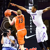 Sophomore guard Marcus Foster tries to block a layup from Oklahoma State guard Phil Forte III in the second half of the Wildcats' 63-53 defeat of the Cowboys January 24, 2015, in Bramlage Coliseum. (Parker Robb | The Collegian)