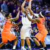 Junior guard Justin Edwards protects the ball as he is surrounded by Oklahoma State guard Anthony Hickey, Jr., (12) and guard Jeff Newberry (22) in the second half of the Wildcats' 63-53 defeat of the Cowboys January 24, 2015, in Bramlage Coliseum. (Parker Robb | The Collegian)