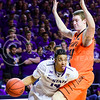 Junior guard Justin Edwards gets a look at the basket as he tries to dribble around Oklahoma State forward Mitchell Solomon in the second half of the Wildcats' 63-53 defeat of the Cowboys January 24, 2015, in Bramlage Coliseum. (Parker Robb | The Collegian)