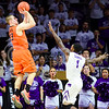 Oklahoma State guard Phil Forte III attempts a three-pointer over K-State sophomore guard Jevon Thomas in the second half of the Wildcats' 63-53 defeat of the Cowboys January 24, 2015, in Bramlage Coliseum. (Parker Robb | The Collegian)