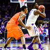 Senior forward Nino Williams keeps the ball away from Oklahoma State forward Le'Bryan Nash in the second half of the Wildcats' 63-53 defeat of the Cowboys January 24, 2015, in Bramlage Coliseum. (Parker Robb | The Collegian)